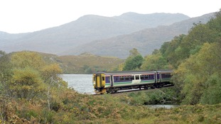 A Train runs along the West Highland Railway line between Fort William and Mallaig