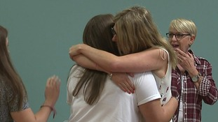 Students embrace in Corby.