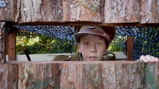 Ethan Harvey, 14, poses in a look-out tower of his person trench