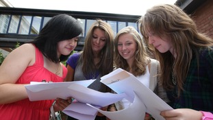 Students reading their results.