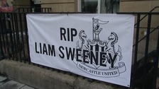 Mourners put out banners to remember Liam