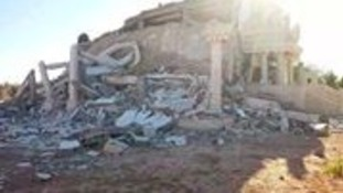 A house in Benghazi reduced to rubble by rocket attacks