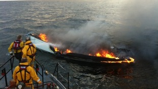 Hartlepool RNLI all-weather lifeboat and the burning yacht