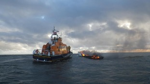 Hartlepool RNLI all-weather and inshore lifeboats and the burning yacht