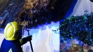 Firefighters tackle thatched roof fires