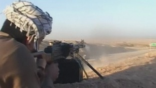 Fighters fires a rifle.