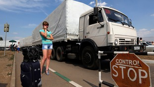 A Russian convoy drives onto the territory of a Russia-Ukraine border crossing point at Donetsk.