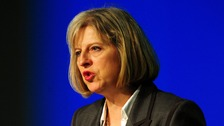 May announces new laws to tackle British extremism