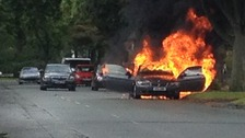 The BMW ablaze in Davyhulme this morning