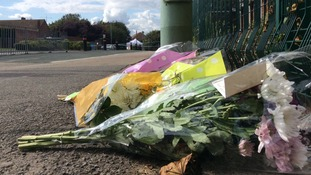 Flowers laid on the street in Watford following the death of Aqeel Khan
