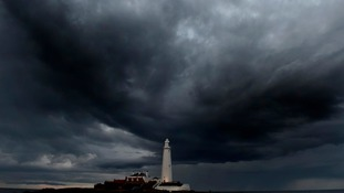 Storm clouds gathering over St. Mary's lighthouse in Whitley Bay