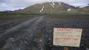 A warning sign blocks the road to Bardarbunga volcano