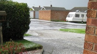 Hail covering the roads in Belton, Norfolk.