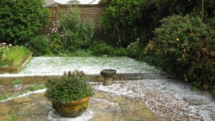 Hail covering a garden in Belton, Norfolk.