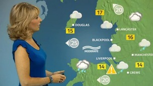 Emma Jesson in front of weather map