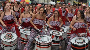 Drummers march at the rain swept Notting Hill carnival.