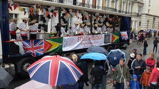 A float makes its way through the streets of Notting Hill.