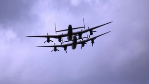 Two Lancaster bombers piggy backing each other in fly past over Louth, Lincs