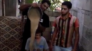 A Gazan family takes part in the 'remains challenge'.