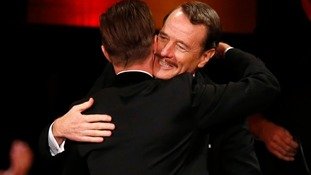 Bryan Cranston and Aaron Paul embrace.