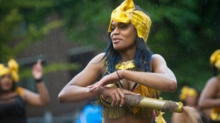 The show goes on at a wet Notting Hill Carnival yesterday