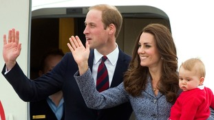 The Duke and Duchess of Cambridge and Prince George wave.