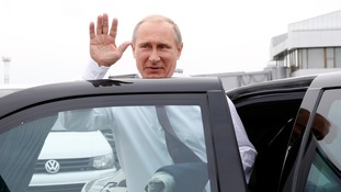 Russian President Vladimir Putin gets into a car.
