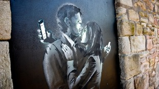 PA photo of Banksy's Mobile Lovers before it was removed from the wall