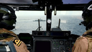 HMS ARGYLL's Lynx helicopter maintains a visual during boarding operations.