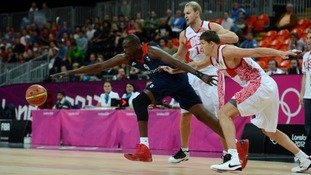 Luol Deng in action against Russia's Victor Khryapa in the Basketball Arena in London in 2012