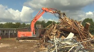 Digger demolishing former MoD site in Bath