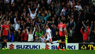 Millton Keynes Dons' Will Grigg scores 2nd goal against Manchester United.