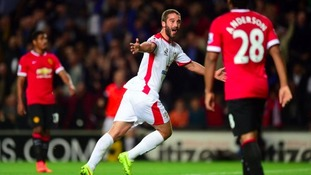 Will Grigg celebrates scoring against Man Utd.