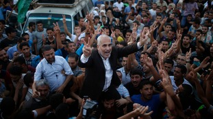 Hamas spokesman Fawzi Barhoum is carried by Palestinians as they celebrate the latest ceasefire deal