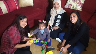 Hala with her mother and the host family who are looking after her.