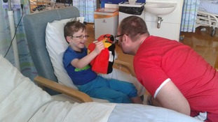 Callum recovers in hospital with his father Andy at his bedside