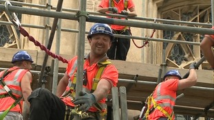 Scaffolder, Adam Watson attracts the crowds with his singing.