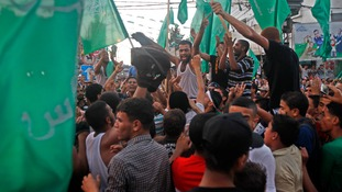 Palestinians in Gaza celebrate after the ceasefire was announced.
