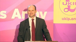 Douglas Carswell announcing his defection to Ukip at a press conference.