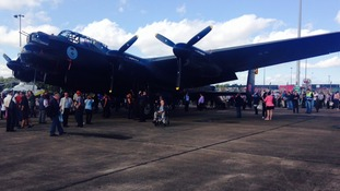 Lancaster bomber returns to airfield where it was based in WWII