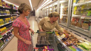 2 women at freezer aisle in supermarket