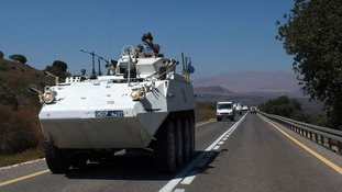 An armoured vehicle carrying UNDOF peacekeepers near the  Quneitra border crossing