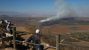 Smoke rises from the Quneitra border crossing in Golan Heights after it came under attack on Wednesday