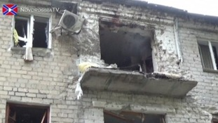 A balcony and windows blown out by shelling at an apartment block in Donetsk