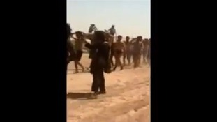 The video goes on to show what appears to be the men dead in the sand