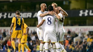 Tottenham celebrate the third goal at White Hart Lane.