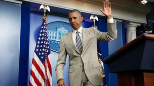 Barack Obama's suit was a break from his normal blue or grey.