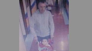 A cctv image of Ashya King and his father