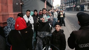 People waiting outside the Pakistani High Commission in Birmingham