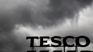 Grey clouds above a Tesco store